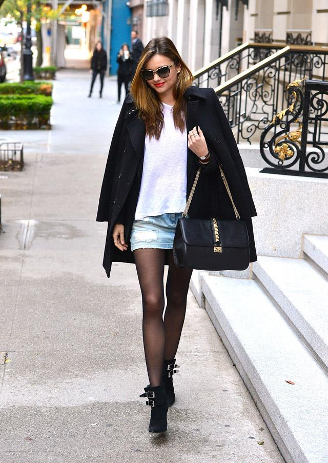 <strong>November 4, 2013</strong><br><br> Miranda proves she's one of the few people who can pull off stockings and a denim-mini in this chic off-duty ensemble.