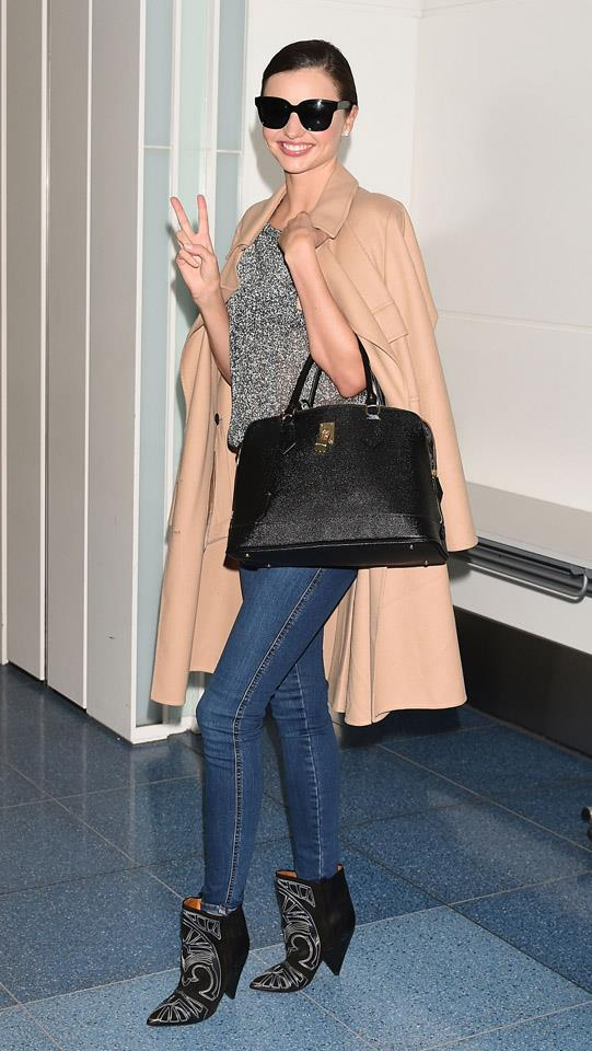 <strong>March 13, 2015</strong><br><br> Miranda rocked an eternally-stylish camel coat in transit at Haneda airport in Tokyo.
