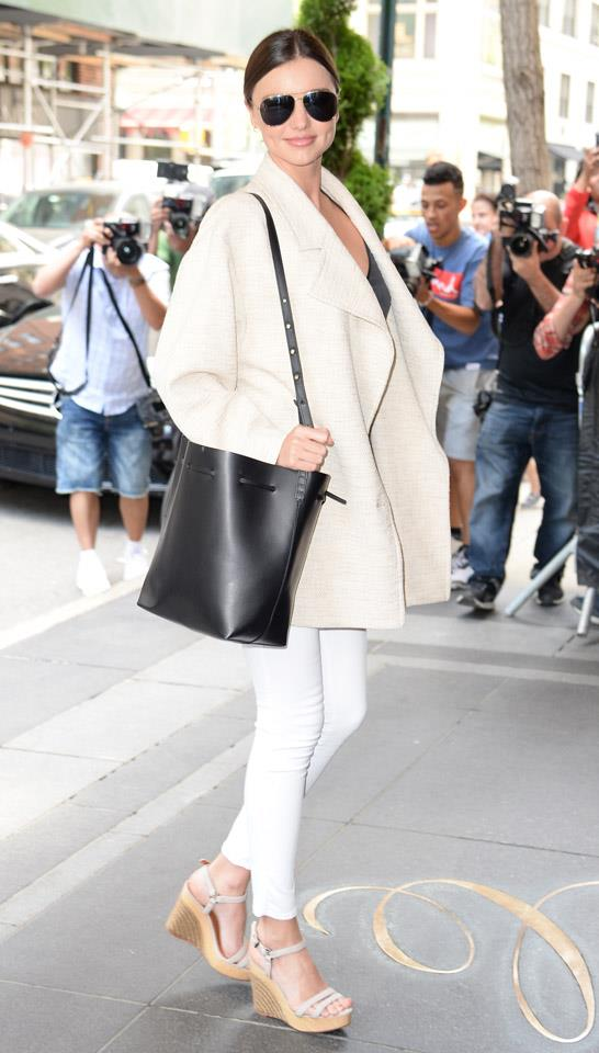 <strong>May 4, 2015</strong><br><br> Miranda rocked the cult Mansur Gavriel bucket bag with a contrasting cream ensemble to take a stroll in New York city.