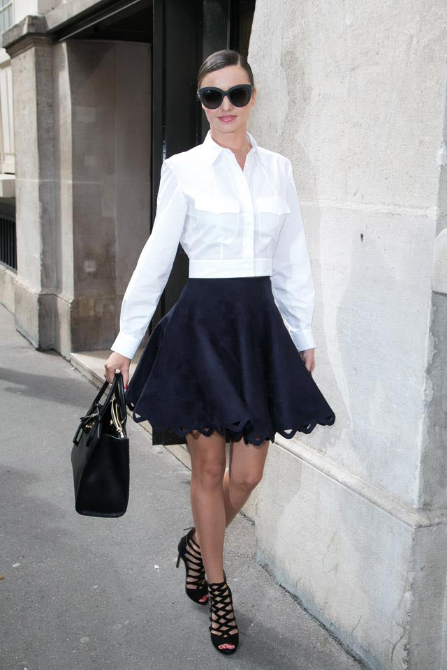 <strong>October 7, 2015</strong><br><br> Miranda changes into a crisp white shirt and full feminine skirt during Paris fashion week.