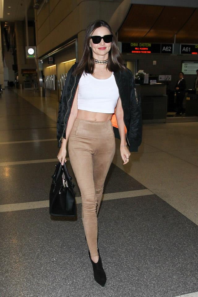 <strong>December 5, 2015</strong><br><br> Miranda swapped a camel trench for a camel pant and a '90s-esque choker in-transit at LAX airport.