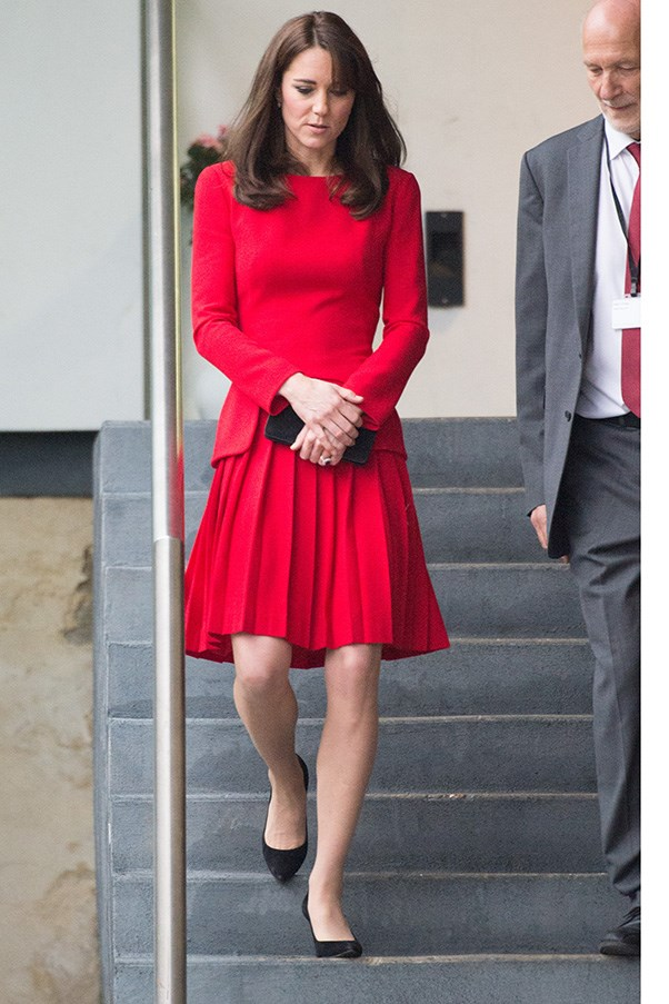 The Duchess got into the festive spirit in a red Alexander McQueen coat-dress at the Anna Freud Centre's Christmas party.