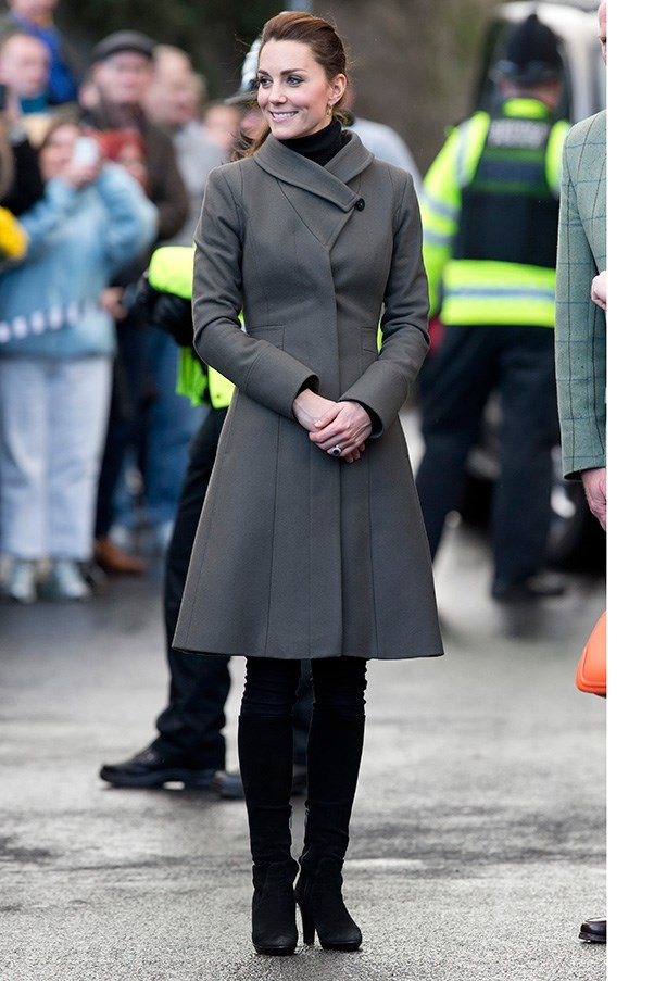 A grey Reiss coat and over-the-knee black suede boots were the outfit of choice for the Duchess during a trip to Wales.
