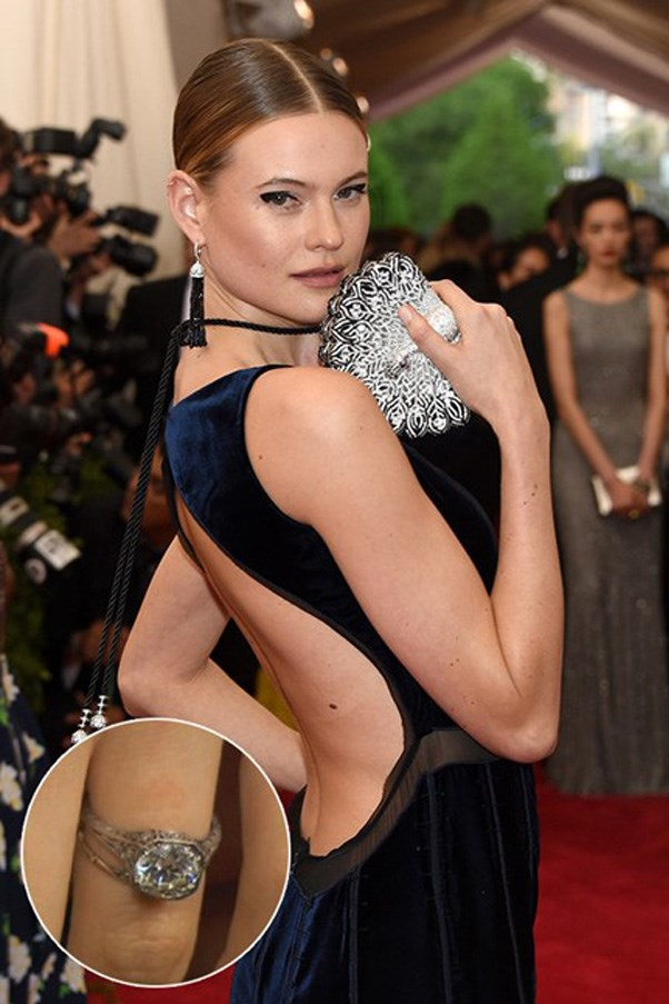 Behati Prinsloo wears this vintage 1930s diamond from husband Adam Levine.