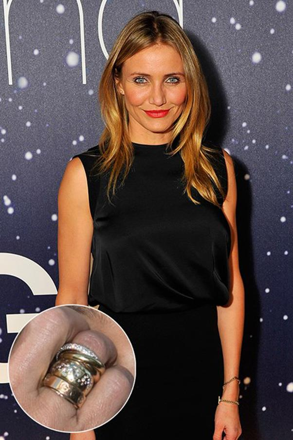 Cameron Diaz's chunky yellow gold and diamond ring from Benji Madden pairs with her wedding band.