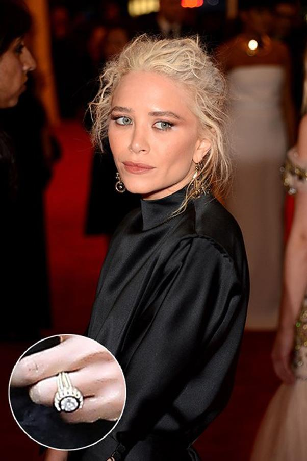 At least she's consistent! Mary-Kate Olsen went alternative with a diamond and sapphire art deco ring from Olivier Sarkozy.