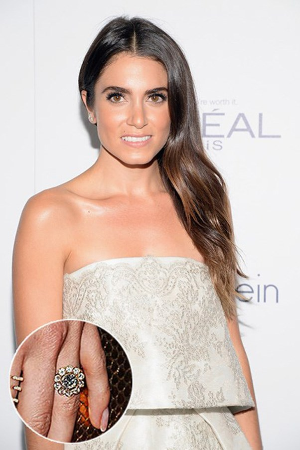 Nikki Reed wears a daisy-design diamond ring from Ian Somerhalder.