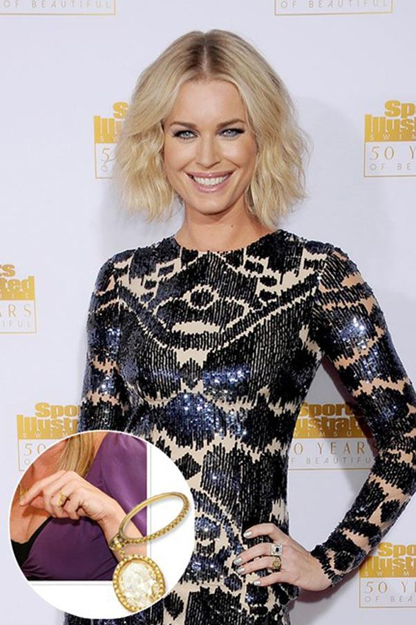 After removing it during her pregnancy, Rebecca Romijn had her engagement ring altered so the stone dangled off the band.