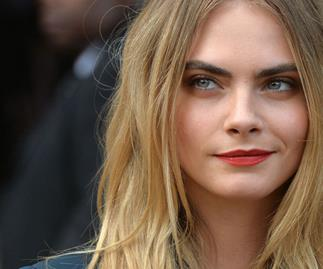 Cara Delevingne takes revenge on paparazzi with water guns