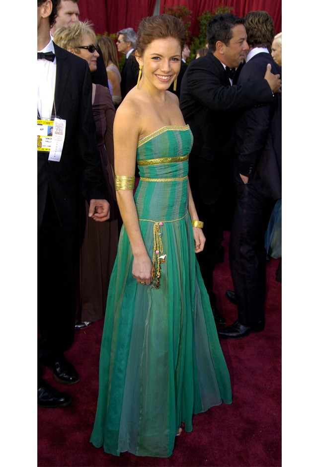 Losing her signature blond locks, Sienna went for a Grecian-inspired gown at the 76th Annual Academy Awards, 2004.