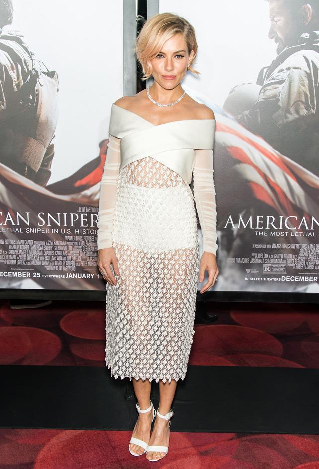 Sheer cut outs are quickly becoming a staple in Sienna Miller's wardrobe, wearing all white Balenciaga at the American Sniper New York premiere in 2014.