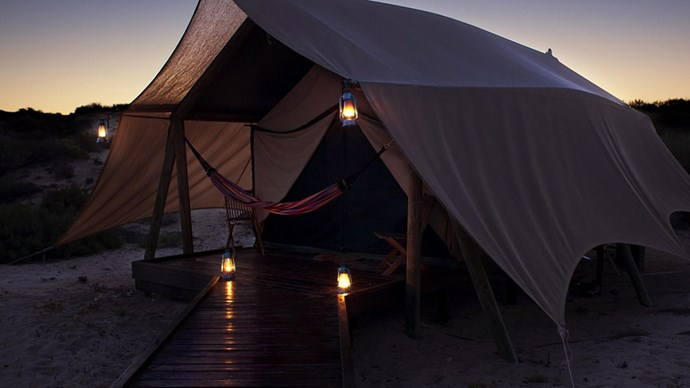 """<strong>NINGALOO REEF: </strong> W.A. does Glamping <br></br> <a href=""""http://www.salsalis.com.au/accommodation/tents"""">Salsalis</a>' 500 thread count organic cotton sheets is definitely less camping and more luxe with all the perks of intrepid travel. Kayaking, snorkelling, and swimming with sharks (whale sharks, obvs) for those with an adventurous spirit, and gourmet dining for those less so."""