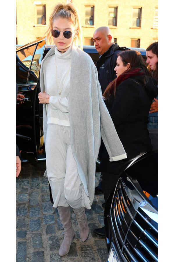 """The model looks perfectly put-together yet effortlessly cozy in gray separates topped off with a <a href=""""http://www.nililotan.com/"""">Nili Lotan</a> coat."""