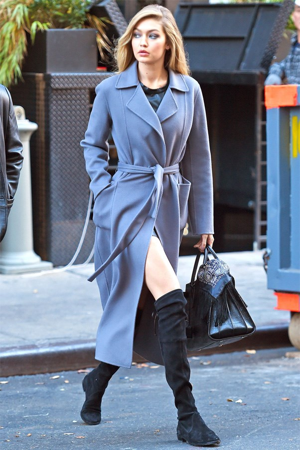 Leaving her Maybelline photo shoot in New York wearing a blue Iris Von Arnim trench coat and knee high boots.