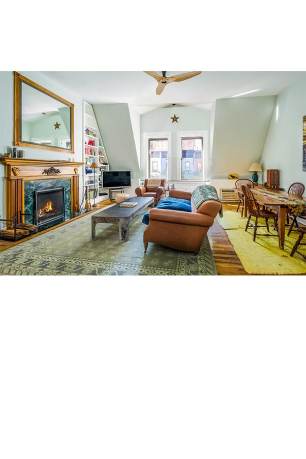 With a third fire place, we can definitely picture snuggling up during New York winters in this apartment.