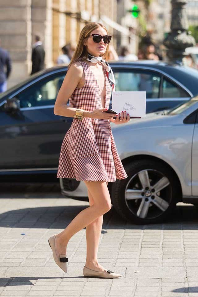 Olivia Palermo makes a flippy hem office-appropriate with a prim neck tie and closed-toe pumps.