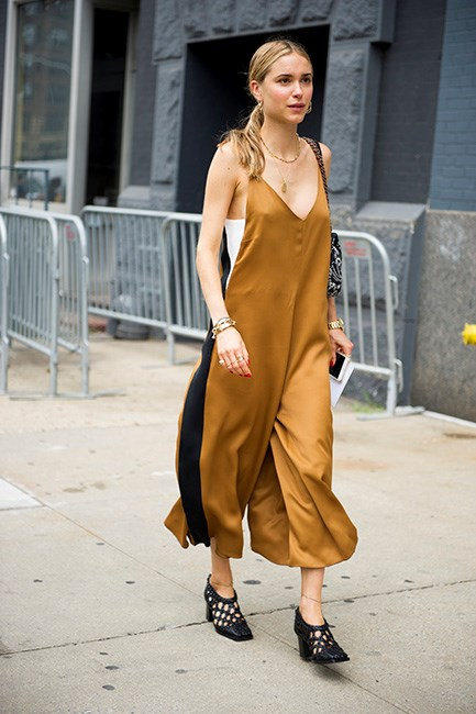Make a slip dress more office-appropriate by layering a tank underneath and teaming with a solid shoe. It helps undo those boudoir overtones.
