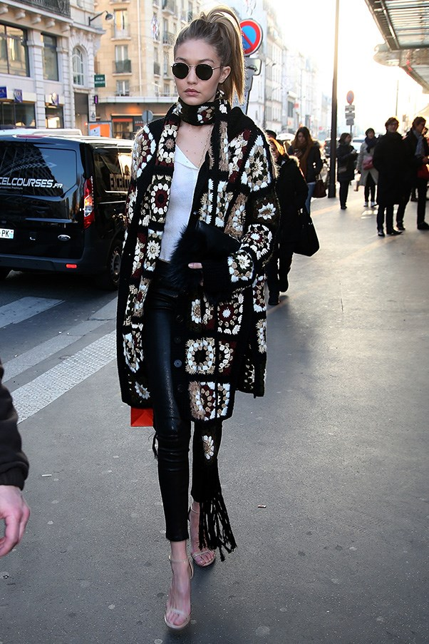 Gigi stepped out in a knitted floral coat and scarf ensemble by Rosetta Getty, paired with leather trousers.