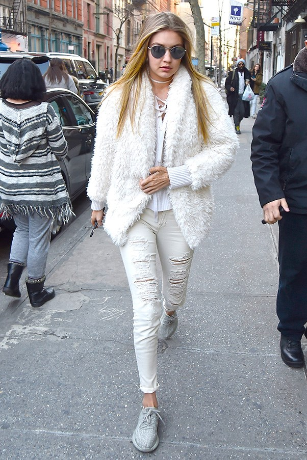 Out in winter whites from the shaggy jacket to the distressed denim. No better way to combat the Manhattan chill.
