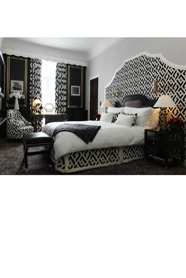 """<strong>Diane von Furstenberg's Claridge's Suite, London</strong> <br><br> DVF's love of patterns—and her iconic chain print—come to life in The Grand Piano Suite at at Claridge's London. The two bedroom, 1915 square foot suite boasts a private bar, marble fireplaces, a grand piano and wall art of photographs taken by Diane herself on her worldly travels. Occupants also have access to a 24 hour personal butler service. <br><br> The Grand Piano Suite at Claridge's London, for more information and bookings, <a href=""""http://www.virtuoso.com/hotels/6163909/claridges?search=claridge%27s&mode=Gts#.U9_Y0zcnLcs"""">virtuoso.com</a>"""