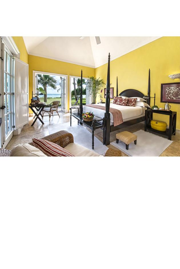 """<strong>Oscar de la Renta's Tortuga Bay Hotel, Punta Cana</strong> <br><br> Oscar de la Renta designed the entire Tortuga Bay Hotel in his native Dominican Republic. Located on a private beach, the late designer's hotel is comprised of 13 villas, a golf course, a Six Senses Spa, tennis centre and a 1,500-acre Ecological Reserve. The most luxurious villa includes four bedrooms leading out to the beach where a personal villa manager tends to all of the guests' needs. <br><br> Tortuga Bay Hotel, for more information and bookings, <a href=""""http://www.virtuoso.com/hotels/6163889/tortuga-bay-hotel?search=Tortuga%20Bay%20Hotel&mode=Gts#hotelInfoTab"""">virtuoso.com</a>"""