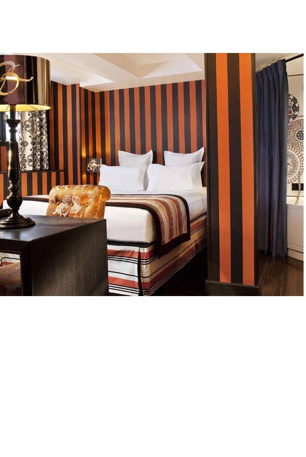 """<strong>Christian Lacroix's Hotel le Bellechasse, Paris</strong> <br><br> Inspired by the 19th-century artistic and cultural atmosphere of its Left Bank location, Christian Lacroix's boutique hotel boasts 34 ornately designed rooms. The hotel includes a terrace area and luxuriously decorated breakfast room designed by Lacroix himself. An added bonus? It's conveniently located steps away from some of Paris's best museums, including the Musée d'Orsay. <br><br> Hotel Le Bellechasse, <a href=""""http://www.lebellechasse.com/en/hotel.html"""">lebellechasse.com</a>"""