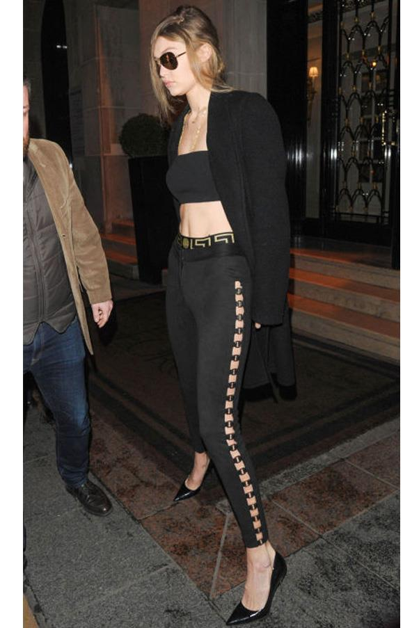 Gigi Hadid ups her pants game in a pair of Vatanika suede leggings with killer hardware details.