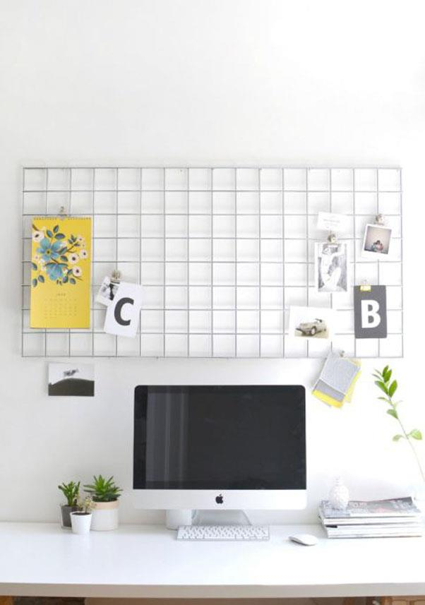 """<em><strong>Problem: Not Enough Desk (Or Counter) Space</strong></em><br><br> Blogger Caroline Burke's repurposed <a href=""""http://www.burkatron.com/2015/06/diy-home-office-metal-memo-board.html"""">metal mesh wall hanger</a> could work equally well in a home office (one corner of your kitchen) or as an impromptu prep station (the other corner of your kitchen.)"""