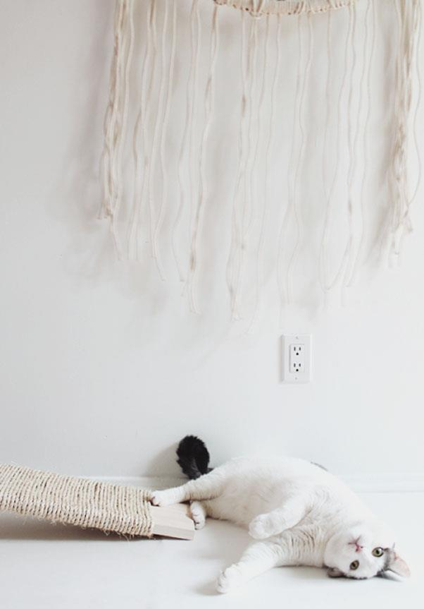 """<em><strong>Problem: Cat-Ravaged Upholstery</strong></em><br><br> Nothing makes a love seat look worse than cat-ravaged upholstery. Let furniture shine in cramped quarters by keeping Mr. Pickles preoccupied with Almost Makes Perfect's <a href=""""http://www.almostmakesperfect.com/2015/04/28/diy-cat-scratcher/"""">wood and twine creation</a>."""