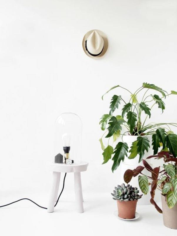 """<em><strong>Problem: Unflattering Lighting</strong></em><br><br> This minimalist lamp is a stroke of genius—and one with a tiny footprint, no less. A <a href=""""http://monsterscircus.com/2015/02/18/diy-lamp-stool/"""">repurposed stool</a>, some paint and a lightbulb combine to make for an eye-catching small space solution from Monsters Circus."""