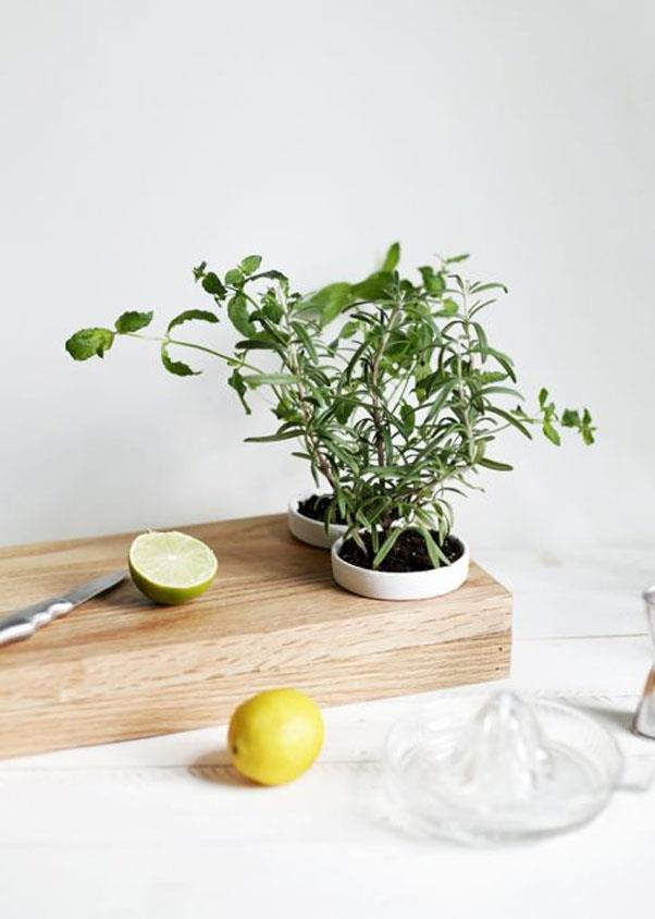 """<em><strong>Problem: No Outdoor Space</strong></em><br><br> Brighten up your food prep routine with The Merry Thought's practical yet unexpected <a href=""""http://themerrythought.com/diy/diy-herb-planter-cutting-board/"""">spin on a pair of kitchen staples</a> — an herb planter and a cutting board."""