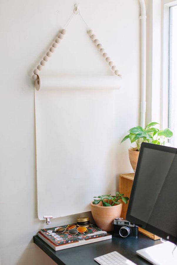 """<em><strong>Problem: Too Many To-Do Lists</strong></em><br><br> A super-simple <a href=""""http://apairandasparediy.com/2015/10/quick-diy-beaded-hanging-noteroll.html"""">jumbo notepad</a> with just a dash of beaded panache make for a simple, sleek command center in this office by A Pair and A Spare DIY."""