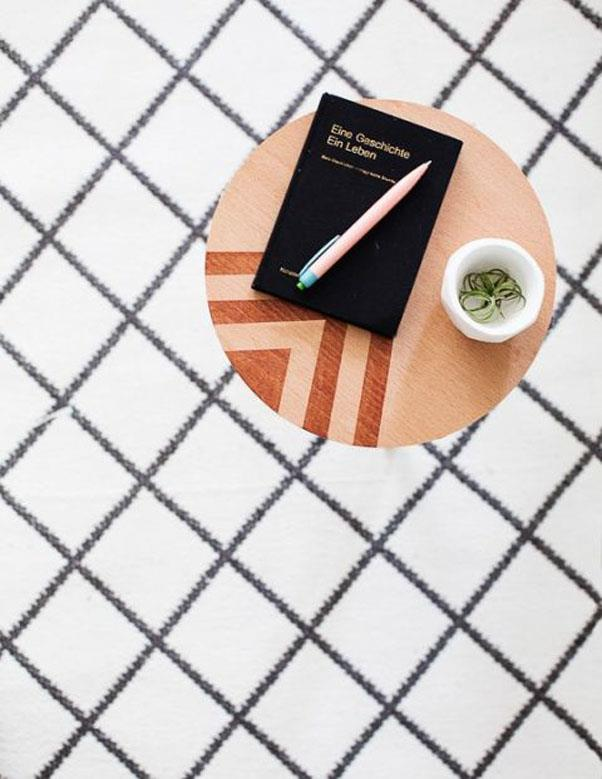 """<em><strong>Problem: No Room For A Coffee Table</strong></em><br><br> This adorable <a href=""""http://sugarandcloth.com/2015/12/diy-mini-patterned-side-table/"""">little table</a> from Sugar & Cloth can double as a plant stand and is constructed of easy-to-find MDF and wooden dowel rods."""