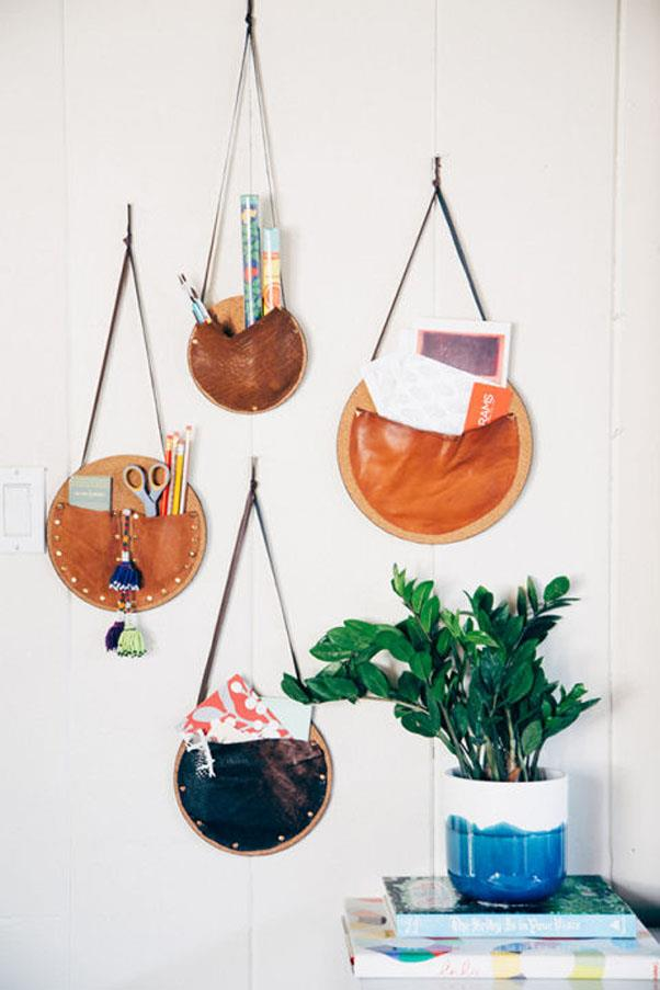 """<em><strong>Problem: A Cluttered Entryway</strong></em><br><br> With just leather scraps, one trip to Lowe's and a little ingenuity, The Jungalow blogger Justina Blakeney was able to make these versatile —and eye-catching — <a href=""""http://www.thejungalow.com/2014/09/diy-catch-all-wall-pockets.html"""">wall pockets</a>."""