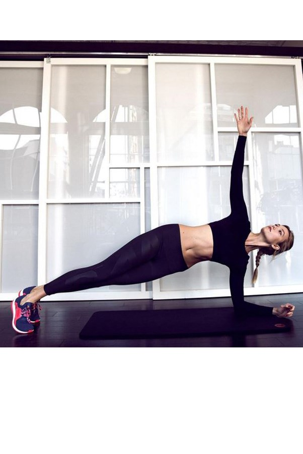 """<strong>KARLIE KLOSS</strong> <br><br> <a href=""""https://www.instagram.com/p/BBNSuC0ESha/?taken-by=karliekloss"""">@karliekloss</a> <br><br> 90 degrees 📐#pureboostx @adidasrunning <br><br> <strong>AB SCULPTOR</strong> <br><br> Start in a plank position with the resistance band around your ankles. Slowly bring your right knee to the outside of your right arm, then back to plank; repeat 12 times. Hold the last one in, do 12 micro pulses in and out, then switch legs. The key to scooping out a flat belly: Move in slow-mo. """"When you do this move at 100 miles an hour, which most people do, your brain and body don't connect,"""" he says. """"Your body thinks you're going through a crazy motion for no reason, and you don't tap into the real body benefit."""""""