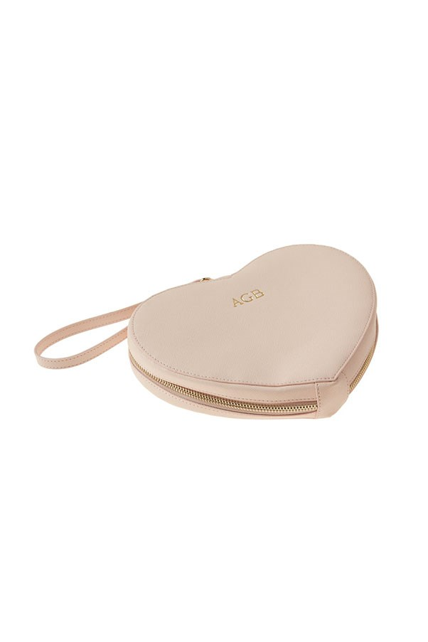 """The Daily Edited Monogrammed Heart Clutch, $119.95, available on preorder <a href=""""https://thedailyedited.com/shop/pale-pink-heart-clutch-pre-order/"""">online</a>"""