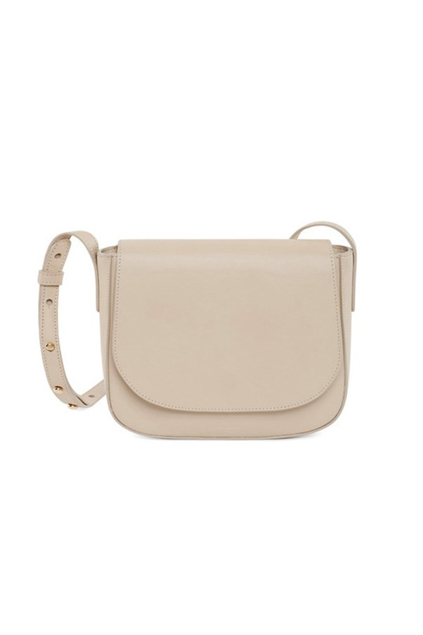 "<strong>BUY</strong> <BR><BR> Mansur Gavriel calf crossbody bag in 'Sand', $850, <a href=""https://www.mychameleon.com.au/calf-crossbody-bag-sand-p-3695.html"">My Chameleon</a>"