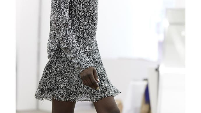 Seeing the dress walk. Baked silver sequins bring texture and movement.