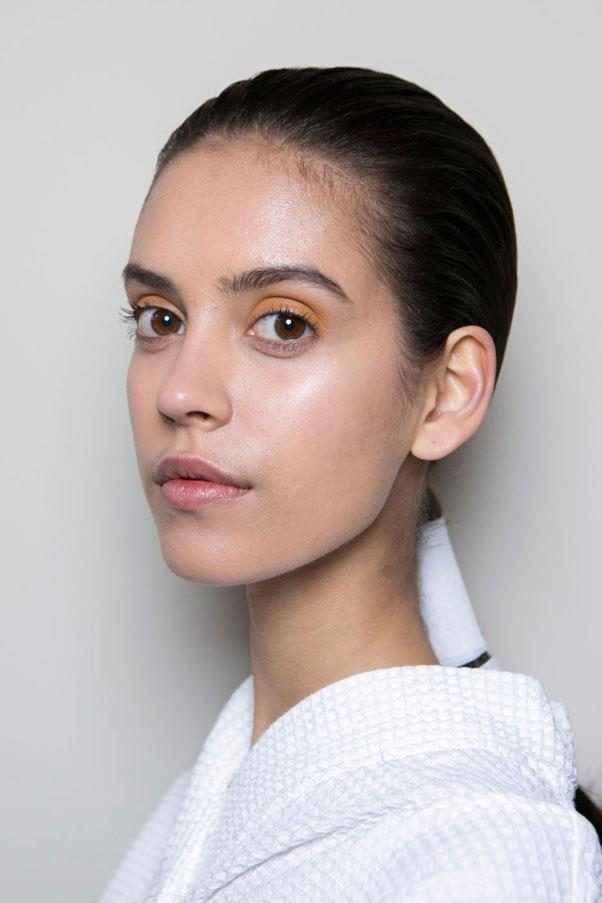 <strong>VICTORIA BECKHAM</strong> <br><br> Earthy brown and green tones were used on models' eyes at Victoria Beckham, while their hair was fastened back into low, sleek ponytails. <br><br> Imaxtree