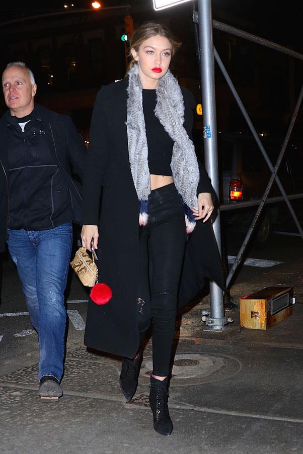 Experimenting with different textures, fur trimmed scarf and fuzzy bag charm, Hadid steps out in New York City.