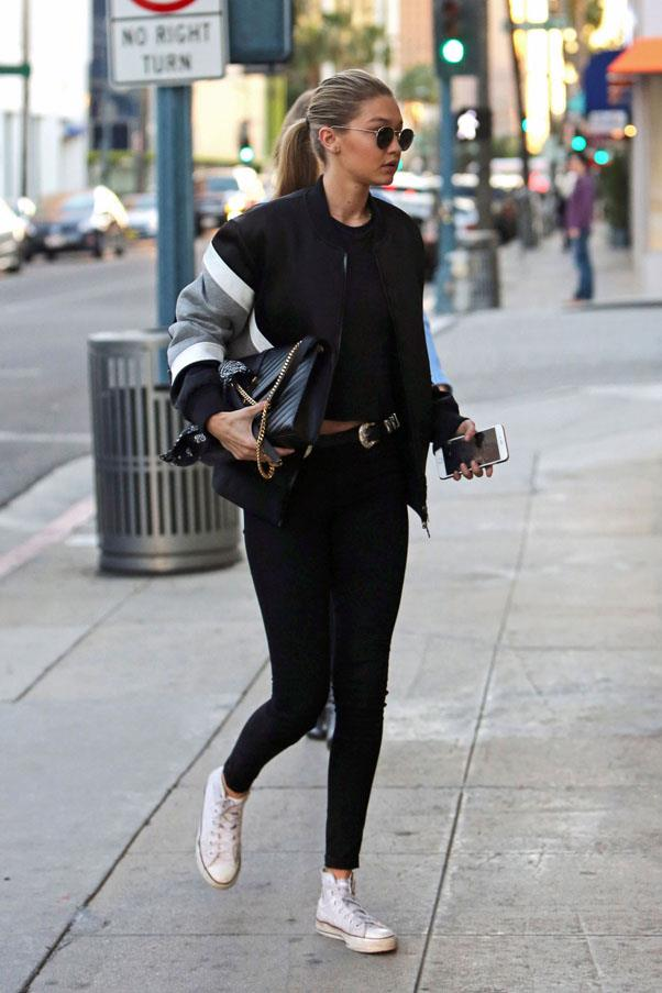 Hadid rocking the sports luxe look in a bomber jacket, leggings and trusty white Converse sneakers. <strong>February 9th, 2016</strong>