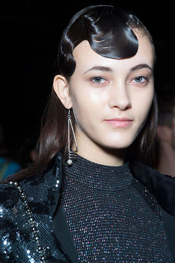 <strong>OPENING CEREMONY</strong><br><br> High shine finger waves were teamed with glossy loose hair at Opening Ceremony for an eye catching dual-texture look.<br><br> Jason Lloyd-Evans