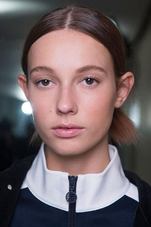 <strong>TORY BURCH</strong><br><br> The messy knots at Tory burch had a sophisticated feel to them with a shiny, healthy finish. The make-up was kept chic and natural with a hint of pink on the lips and dewy skin.<br><br> Jason Lloyd-Evans