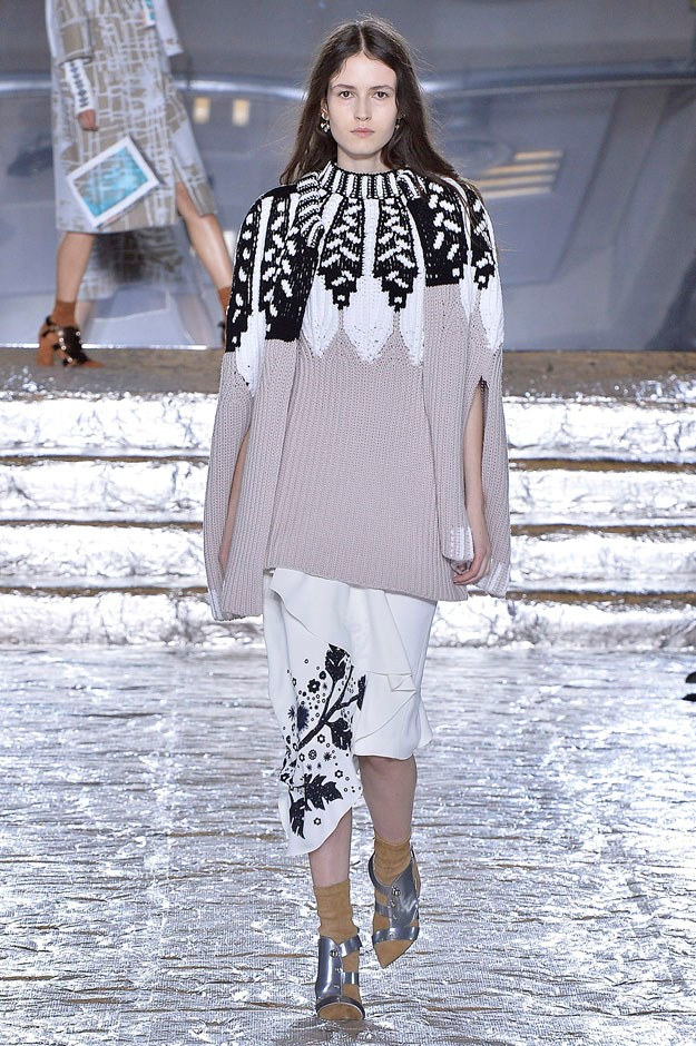<strong>Peter Pilotto</strong> <br><br> One of the best, among many, was a black, white and taupe knit cape worn long and loose over a white frilled skirt and silver sandals. It could be the casual dinner uniform for Aspen, St. Moritz, the sidewalks of any major metropolitan city.