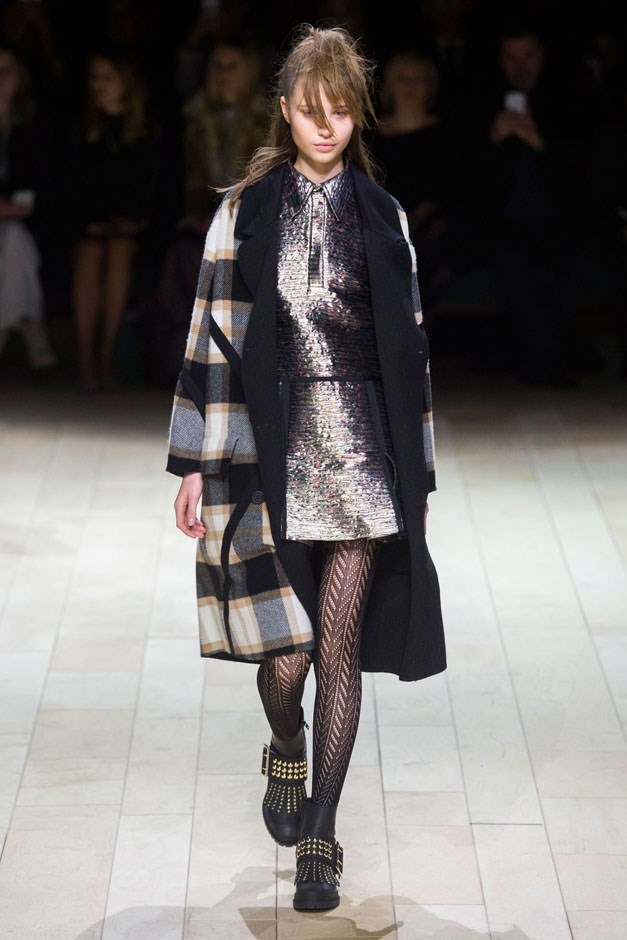 <strong>Burberry</strong> <br><br> Bailey mixed together all of his favorite motifs and some house standards. There were the men's wear checks and plaids, the military codas, the street urchin styling (edge-cut hair and knit tights), British punk ankle boots and an assortment of cool outerwear to last for several winters.