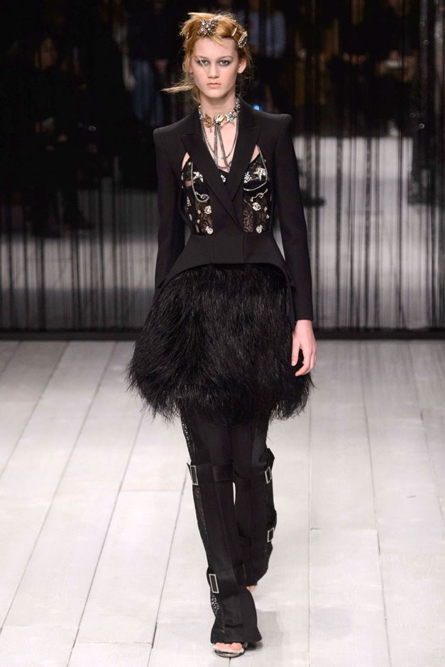 <strong>Alexander McQueen</strong> <br><br> Which is not to say Burton can't cut her suits like a Savile Row master. The black or cream suits and pants—wrapped in belts at the ankle, above the knee and high thigh— looked smart and fresh, and played like foils to all the overt romance. This mama is made of both soft and stern stuff. In essence: thoroughly modern, and fashion is better for it.