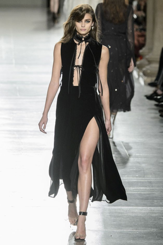 <strong>Topshop Unique</strong> <br><br> Evening wear finished the show with tactile velvets with of the moment, neck tie details and slit up to there skirts—more perfect fare for those girls of the moment and the ones who aspire to cop their style. —Kerry Pieri