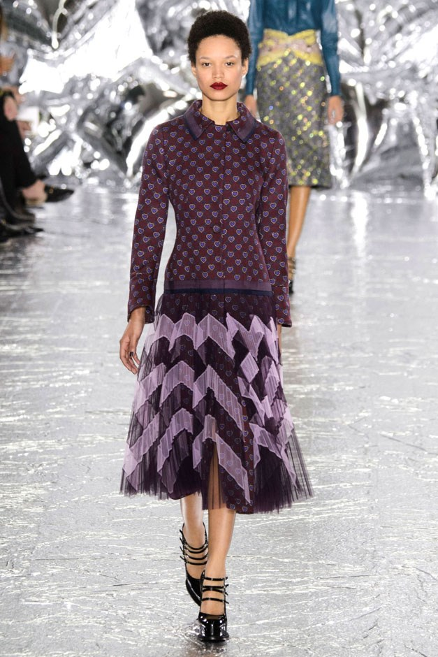 <strong>Mary Katrantzou</strong> <br><br> There was a Fifties feel to her silhouettes—the patterned pencil skirts and pleated flares, all paired up with tone-on-tone collared sweaters or blouses with an explosion of colour and motif (as always, Katrantzou's clothes beg to be viewed up-close for the special details and surprises she adds in, like cut-out arrows, glitter hearts hidden in sturdy tweeds).
