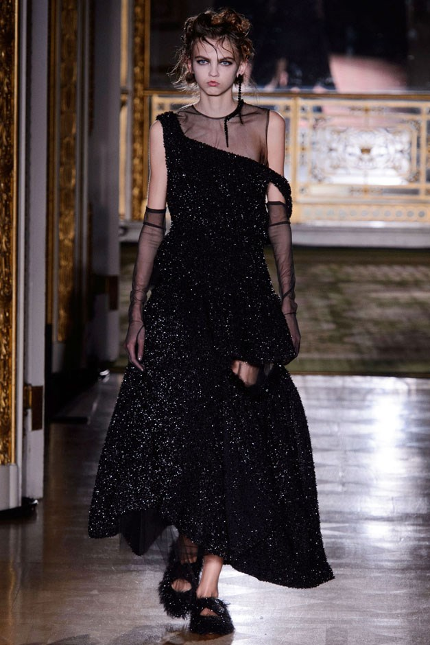 <strong>Simone Rocha</strong> <br><br> A gown that cut away at the leg and seemed to fall apart at the seams with sheer underlay was Rocha's dark romance at its most exquisite. You may not find your weekend brunch look here, but a designer who shows at a space in the same neighborhood as the royal family home is far more interested in outfitting her band of dark mistresses for occasions of note, anyway. —Kerry Pieri
