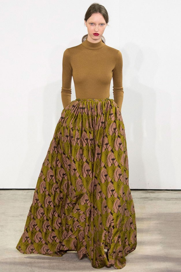 <strong>Emilia Wickstead</strong> <br><br> A printed ball gown skirt in chartreuse and rose was paired with a turtleneck of the same hue, playing to the idea of balance, the juxtaposition of volume and body-conscious.